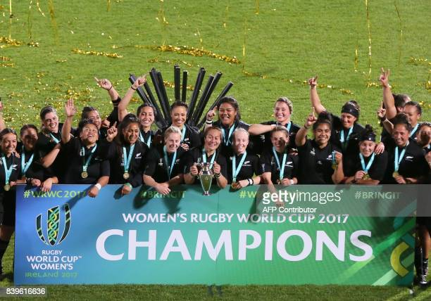 New Zealand's captain Fiao'o Faamausili holds the cup as New Zealand's players celebrate their victory on the pitch after the Women's Rugby World Cup...