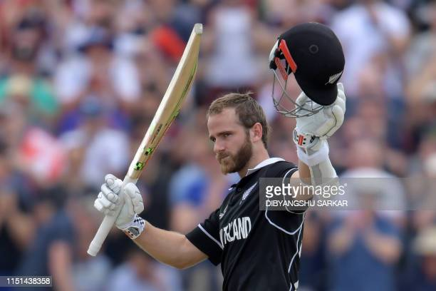 New Zealand's captain Kane Williamson celebrates after scoring a century during the 2019 Cricket World Cup group stage match between West Indies and...
