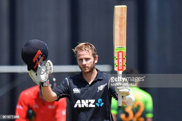 New Zealand's captain Kane Williamson celebrates his century during the first one day international cricket match between New Zealand and Pakistan at...