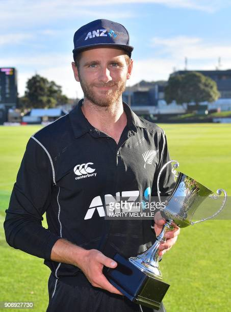New Zealand's captain Kane Williamson holds the trophy during the 5th oneday international cricket match between New Zealand and Pakistan at the...