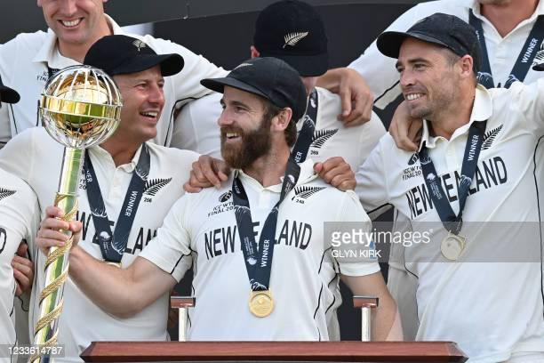 New Zealand's captain Kane Williamson holds the winner's Mace as New Zealand players celebrate victory on the final day of the ICC World Test...