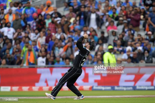 New Zealand's captain Kane Williamson makes the catch to dismiss India's Hardik Pandya for 32 during the 2019 Cricket World Cup first semi-final...