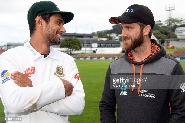 New Zealand's captain Kane Williamson talks with Bangladesh's captain Mahmudullah after the second cricket Test match between New Zealand and...