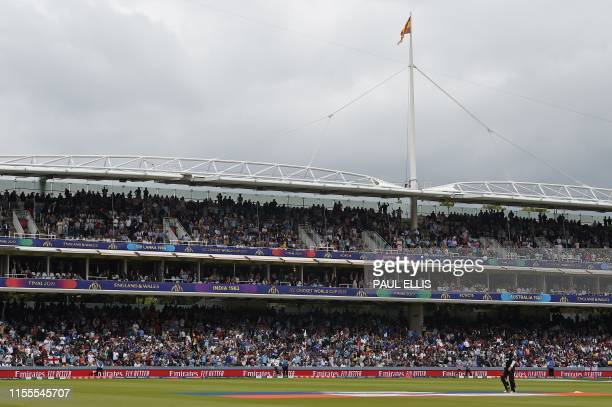 New Zealand's captain Kane Williamson walks back to the pavilion after his dismissal during the 2019 Cricket World Cup final between England and New...