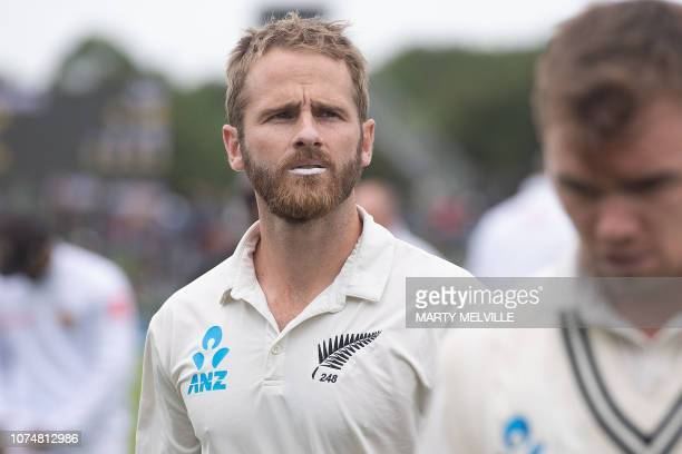 New Zealand's captain Kane Williamson walks from the field after the national anthems during day one of the second Test cricket match between New...