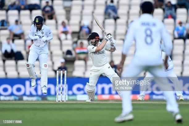 New Zealand's captain Kane Williamson watches the ball after playing a shot on the final day of the ICC World Test Championship Final between New...