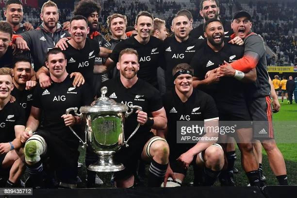 TOPSHOT New Zealand's captain Kieran Read holds the Bledisloe Cup during the second Bledisloe Cup match between New Zealand and Australia under their...