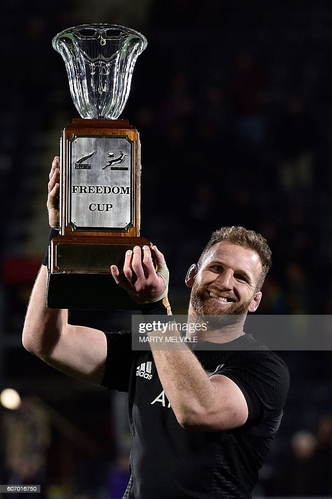 New Zealand's captain Kieran Read holds the Freedom Cup after their win over South Africa during the rugby Test match between New Zealand and South Africa at AMI Stadium in Christchurch on September 17, 2016. / AFP / Marty Melville