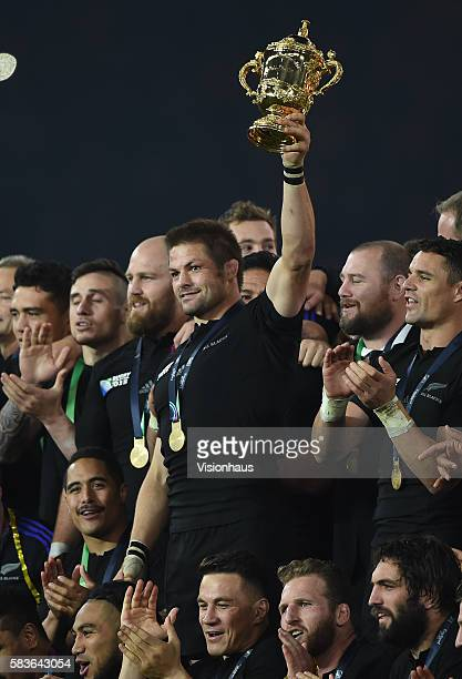 New Zealand's captain Richie McCaw holds the trophy aloft after winning the Rugby World Cup Final between New Zealand and Australia at the Twickenham...