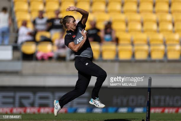New Zealand's captain Sophie Devine bowls during the fifth women's Twenty20 cricket match between New Zealand and England in Wellington on March 7,...