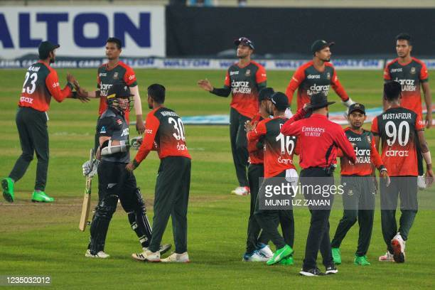 New Zealand's captain Tom Latham shakes hands with Bangladesh's captian Mahmudullah as Bangladesh's cricketers celebrate their victory at the end of...