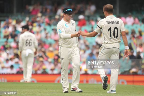 New Zealand's captain Tom Latham speaks to Neil Wagner during the first day of the third cricket Test match between Australia and New Zealand at the...