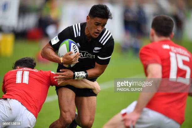 New zealand's centre Bailyn Sullivan runs with the ball during the Rugby Union World Cup U20 championship match New Zealand vs Wales at the...