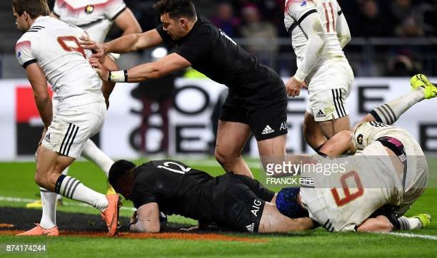 New Zealand's centre Ngani Laumape scores a try during the international rugby union test match between France and the New Zealand All Blacks at...