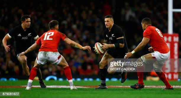 New Zealand's centre Sonny Bill Williams is tackled during the Autumn international rugby union Test match between Wales and New Zealand at the...