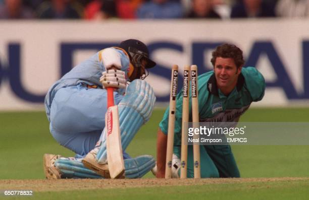 New Zealand's Chris Cairns and India's Robin Singh come face to face after a collision between them