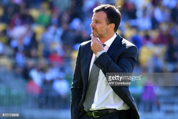 New Zealand's coach Anthony Hudson walks from the field at halftime during the World Cup football qualifying match between New Zealand and Peru at...