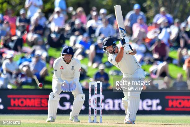 New Zealand's Colin de Grandhomme bats watched by England's keeper Jonny Bairstow during day two of the second cricket Test match between New Zealand...
