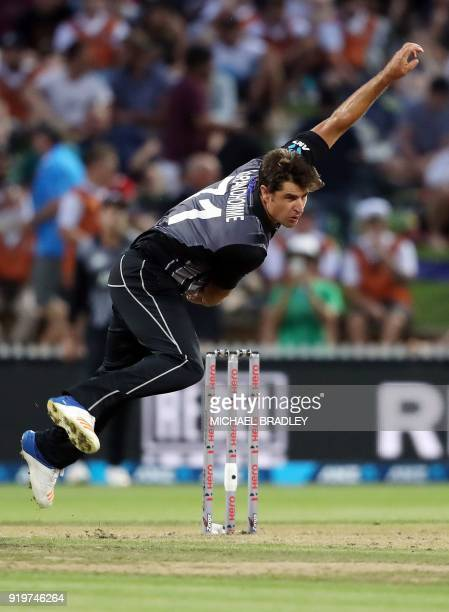 New Zealand's Colin de Grandhomme bowls during the Twenty20 Tri Series international cricket match between New Zealand and England at Seddon Park in...