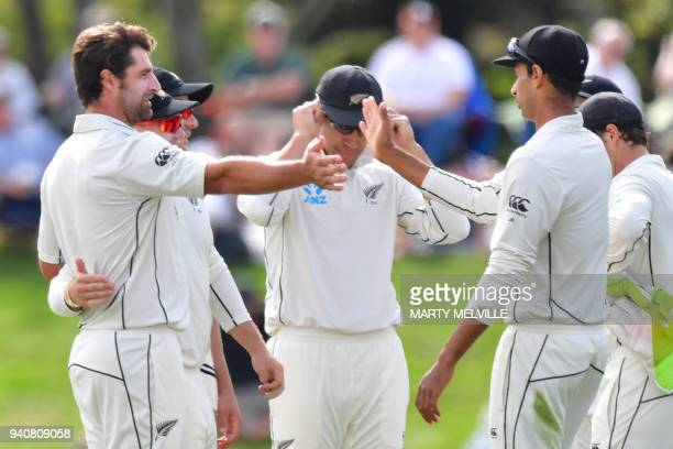 New Zealand's Colin de Grandhomme celebrates England's Dawid Malan being caught with teammate Jeet Raval R during day four of the second cricket Test...