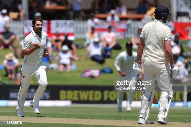 New Zealands Colin de Grandhomme celebrates the wicket of Englands Dom Sibley during the first day of the first cricket test between England and New...