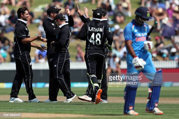 New Zealand's Colin de Grandhomme celebrates the wicket of India's Ambati Rayudu during the fourth oneday international cricket match between New...