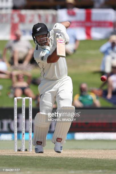 New Zealands Colin de Grandhomme plays a shot during the third day of the first cricket Test between England and New Zealand at Bay Oval in Mount...