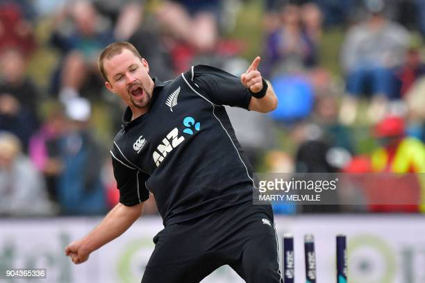 New Zealand's Colin Munro celebrates bowling Pakistan's Shadab Khan during the third one day international cricket match between New Zealand and...