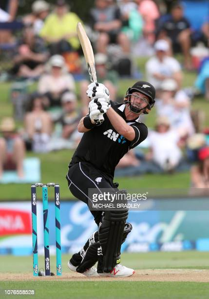 New Zealand's Colin Munro hits a six during the first oneday international cricket match between New Zealand and Sri Lanka at Bay Oval in Mount...