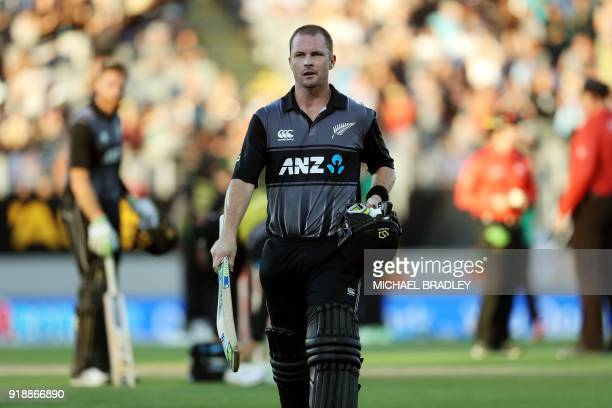 New Zealand's Colin Munro walks off after being dismissed during the Twenty20 Tri Series international cricket match between New Zealand and...