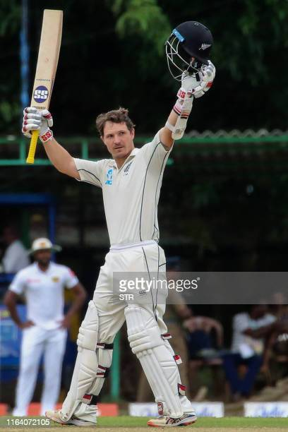 New Zealand's cricketer BJ Watling celebrates after scoring his century during the last day of the final Test cricket match between Sri Lanka and New...