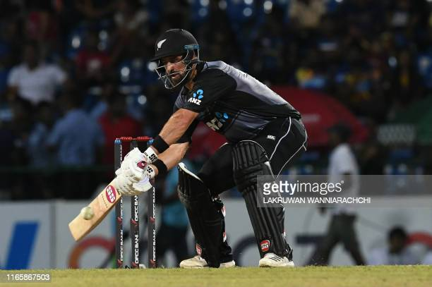 New Zealand's cricketer Colin de Grandhomme plays a shot during the second international Twenty20 cricket match between Sri Lanka and New Zealand at...