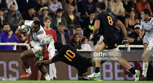 New Zealand's Crusaders wing Manasa Mataele eludes a tackle from Argentina's Jaguares fly half Nicolas Sanchez during their Super Rugby match at Jose...