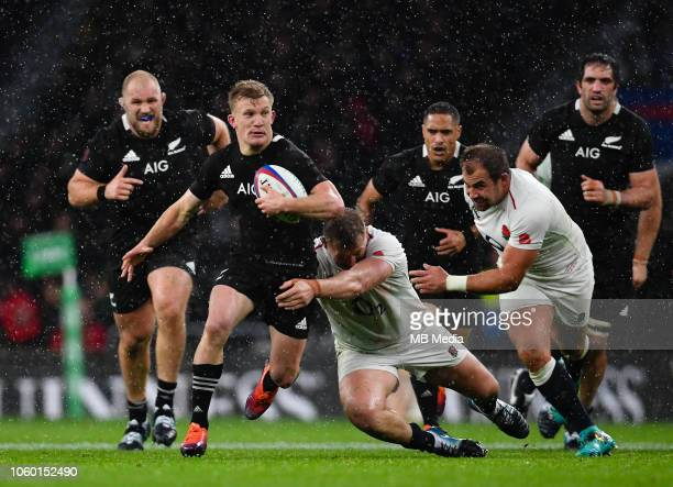 New Zealand's Damian McKenzie evades the tackle of England's Dylan Hartley during the Quilter International match between England and New Zealand at...