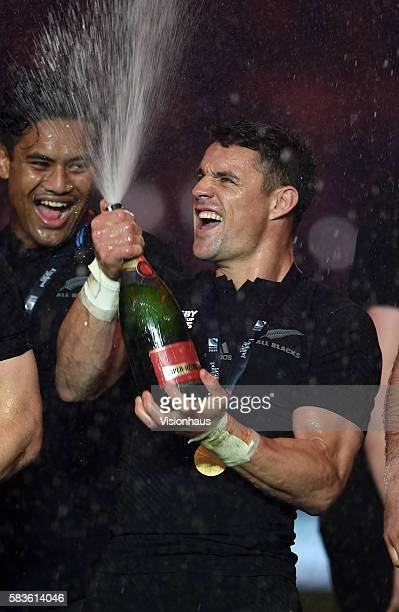 New Zealand's Dan Carter cracks open the champagne after winning the Rugby World Cup Final between New Zealand and Australia at the Twickenham...
