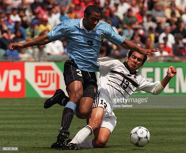 New Zealand's Daniel Trent makes a tackle on Uruguay's Alvaro Meneses in the FIFA under 17 World Championship at North Harbour Stadium Albany...