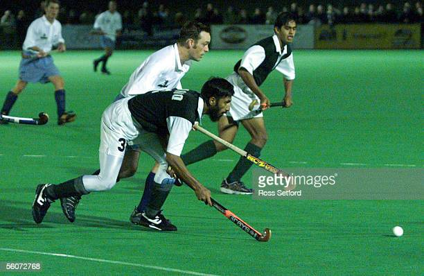 New Zealand's Darren Smith and Pakistan's Tariq Imran chase the ball in the international match at Lloyd Elsmere Park Auckland Tuesday