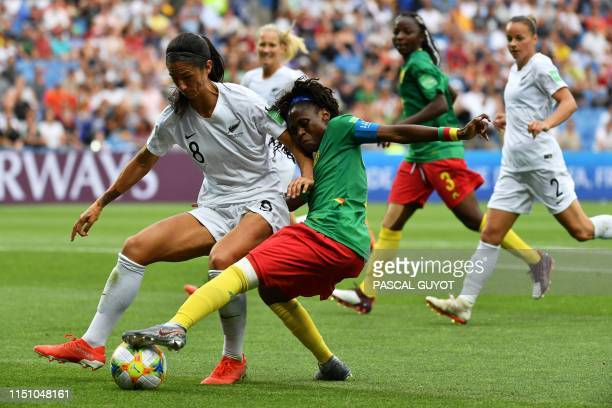 New Zealand's defender Abby Erceg vies for the ball with Cameroon's forward Gabrielle Onguene during the France 2019 Women's World Cup Group E...
