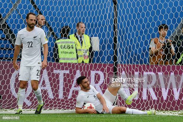 New Zealand's defender Michael Boxall holds the ball as New Zealand's defender Andrew Durante walks away following the first goal by Russia during...