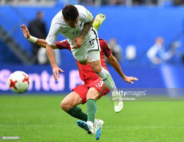 New Zealand's defender Thomas Doyle vies with Portugal's defender Pepe during the 2017 Confederations Cup group A football match between New Zealand...