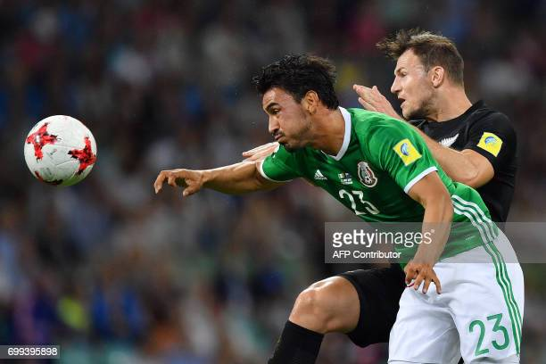 New Zealand's defender Tommy Smith vies with Mexico's midfielder Oswaldo Alanis during the 2017 Confederations Cup group A football match between...