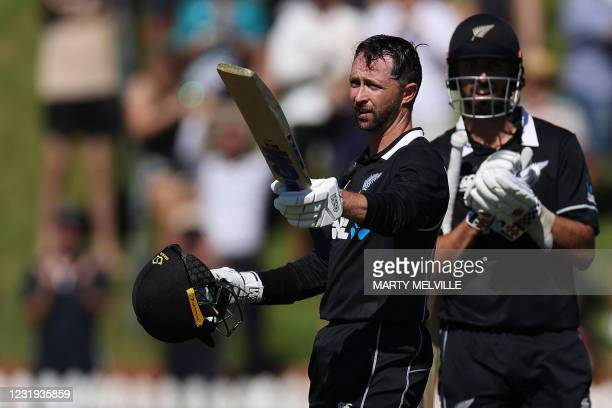 New Zealand's Devon Conway celebrates his century during the third one-day international cricket between New Zealand and Bangladesh at the Basin...