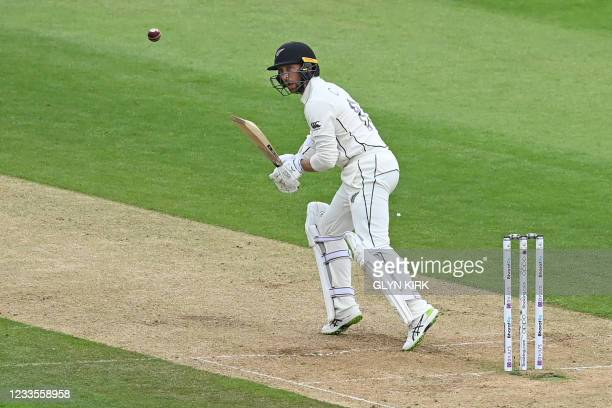 New Zealand's Devon Conway plays a shot on the third day of the ICC World Test Championship Final between New Zealand and India at the Ageas Bowl in...