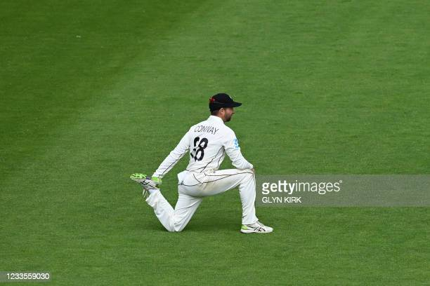 New Zealand's Devon Conway stretches in the field as he prepares to open the batting for New Zealand during play on the third day of the ICC World...