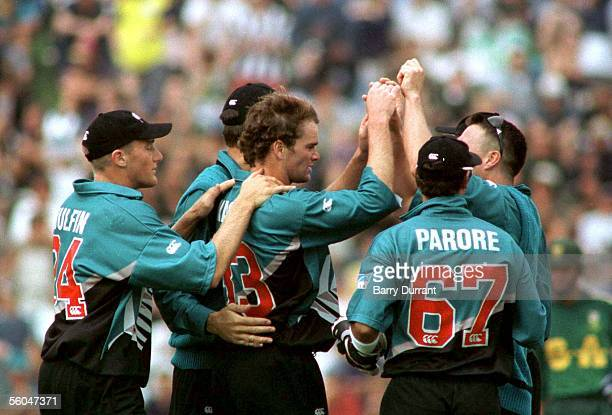 New Zealand's Dion Nash celebrates the bowling of South Africa's Herschelle Gibbs in the final one day international at the Basin Reserve Wellington...