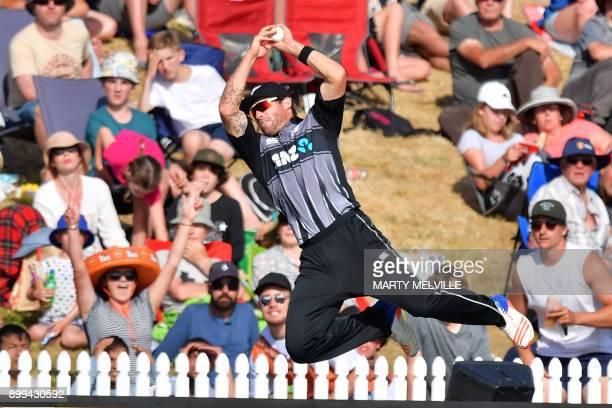 TOPSHOT New Zealand's Doug Bracewell attempts to catch a ball from West Indies batsman Ashley Nurse during the first Twenty20 international cricket...