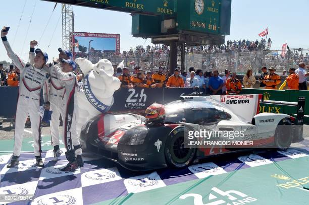 New Zealand's driver Brendon Hartley New Zealand's driver Earl Bamber and German's driver Timo Bernhard take a selfie with their Porsche 919 Hybrid...
