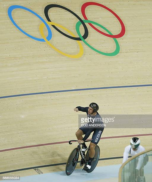 New Zealand's Eddie Dawkins celebrates after beating an Olympic record during the men's Team Sprint qualifying track cycling event at the Velodrome...