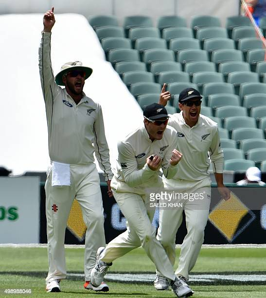 New Zealand's fielders Martin Guptill Ross Taylor and Mark Craig celebrate the dismissal of Australia's batsman Adam Voges off paceman Tim Southee...