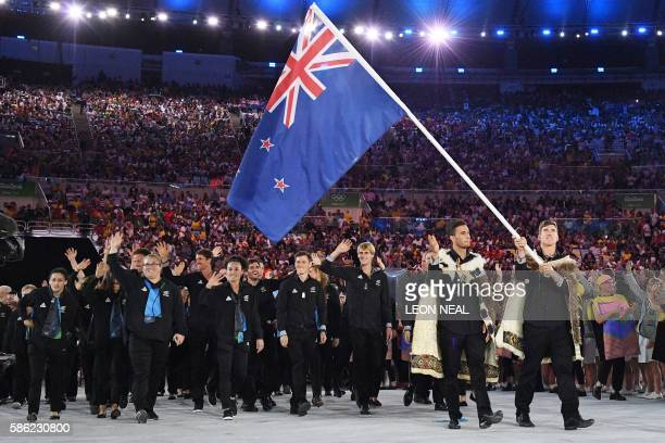 New Zealand's flag bearer Peter Burling leads the delegation during the opening ceremony of the Rio 2016 Olympic Games at the Maracana stadium in Rio...